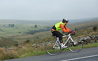27 SEP 2013 - DARTMOOR, GBR - Paul Parrish cycles up a hill on Dartmoor, Devon, Great Britain during the bike leg of the Enduroman 2013 Lands End to London to Dover ultra triathlon (PHOTO COPYRIGHT © 2013 NIGEL FARROW, ALL RIGHTS RESERVED)