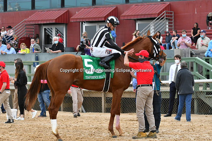 March 13, 2021: Carlos L. #5 , ridden by Alex L. Canchari wins the Temperence Hill Stakes  for trainer McLean Robertson at Oaklawn Park in Hot Springs,  Arkansas. Ted McClenning/Eclipse Sportswire/CSM