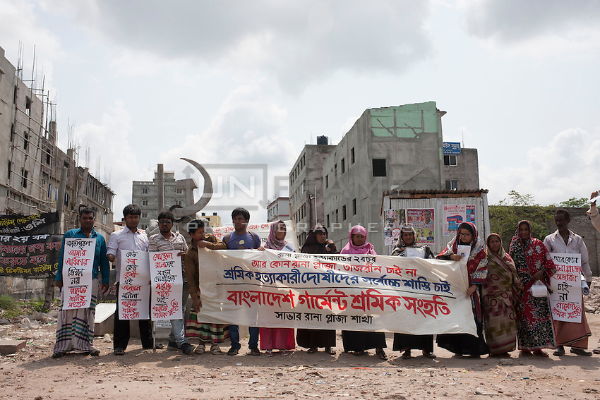 Relatives and former Rana Plaza workers in a protest for demanding their compensation in front of the Rana Plaza collapse site in Savar, near Dhaka, Bangladesh