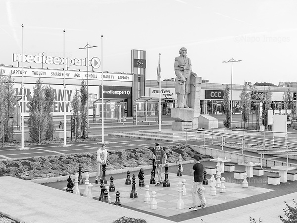 Koscierzyna 22.09.2019 Poland<br /> Young boys play chess in front of the monument of Józef Wybicki, the author of the words of the Polish national anthem in the center of Kościerzyna, a city in the Pomeranian Voivodeship.<br /> Photo: Adam Lach