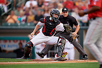 Rochester Red Wings catcher Wynston Sawyer (16) attempts to tag a base runner during an International League game against the Pawtucket Red Sox on June 28, 2019 at Frontier Field in Rochester, New York.  Pawtucket defeated Rochester 8-5.  (Mike Janes/Four Seam Images)