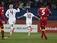 The USA's Landon Donovan celebrates scoring a penalty kick to tie the match 1-1 in a second round match of the 2010 FIFA World Cup between USA and Ghana in Rustenberg, South Africa on Saturday, June 26, 2010.  Ghana won 2-1.  Teammate Micahel Bradley trails behind.