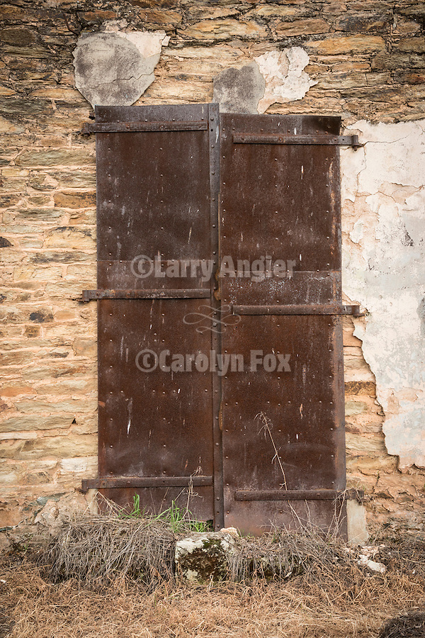 Iorn doors, Gold-Rush era ruins in the Motherlode village of Campo Seco, Calif.