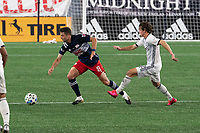 FOXBOROUGH, UNITED STATES - AUGUST 20: Matt Polster #8 of New England Revolution breaks away from Brenden Aaronson #22 of Philadelphia Union during a game between Philadelphia Union and New England Revolution at Gilette on August 20, 2020 in Foxborough, Massachusetts.