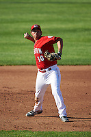 Auburn Doubledays third baseman Jake Jefferies (10) throws to first during a game against the Mahoning Valley Scrappers on June 19, 2016 at Falcon Park in Auburn, New York.  Mahoning Valley defeated Auburn 14-3.  (Mike Janes/Four Seam Images)