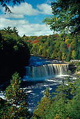 Upper Tahquemenon Falls, in the Upper Peninsula of Michigan, is one of the largest falls east of the Mississippi. It drops fifty feet and is 200 ft wide. Located in Luce county north of Newberry.