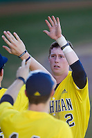 Michigan Wolverines third baseman Jacob Cronenworth (2) after he scored during the NCAA season opening baseball game against the Texas State Bobcats on February 14, 2014 at Bobcat Ballpark in San Marcos, Texas. Texas State defeated Michigan 8-7 in 10 innings. (Andrew Woolley/Four Seam Images)