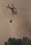 Firefighters battle a 150-acre fire near Holbrook Junction, Nev., on Saturday, Sept. 10, 2011. .Photo by Cathleen Allison