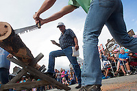 Log sawing competition at Reed Point Great Montana Sheep Drive