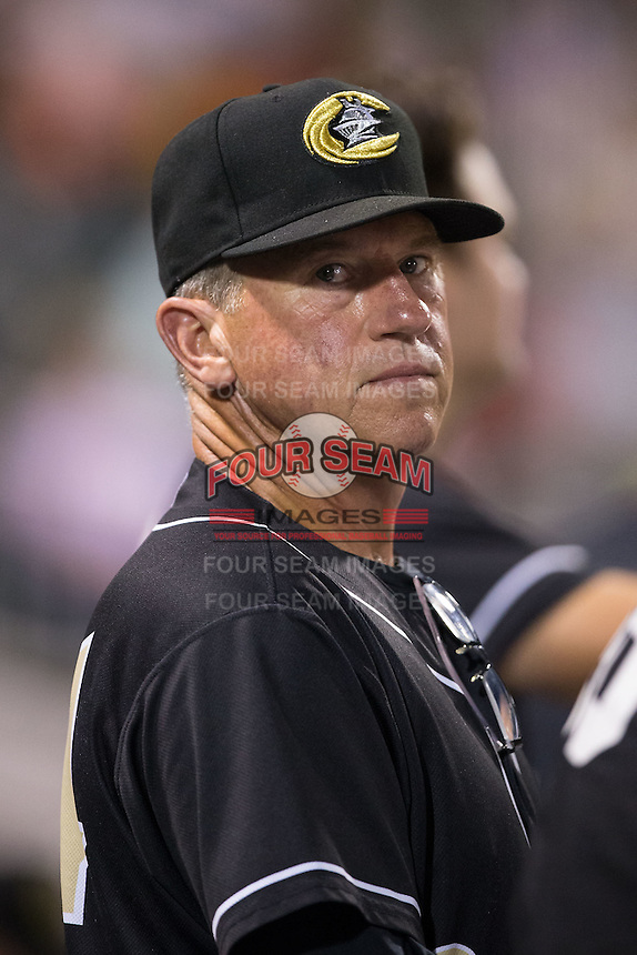 Charlotte Knights pitching coach Richard Dotson (34) looks on during the International League game against the Louisville Bats at BB&T BallPark on May 12, 2015 in Charlotte, North Carolina.  The Knights defeated the Bats 4-0.  (Brian Westerholt/Four Seam Images)