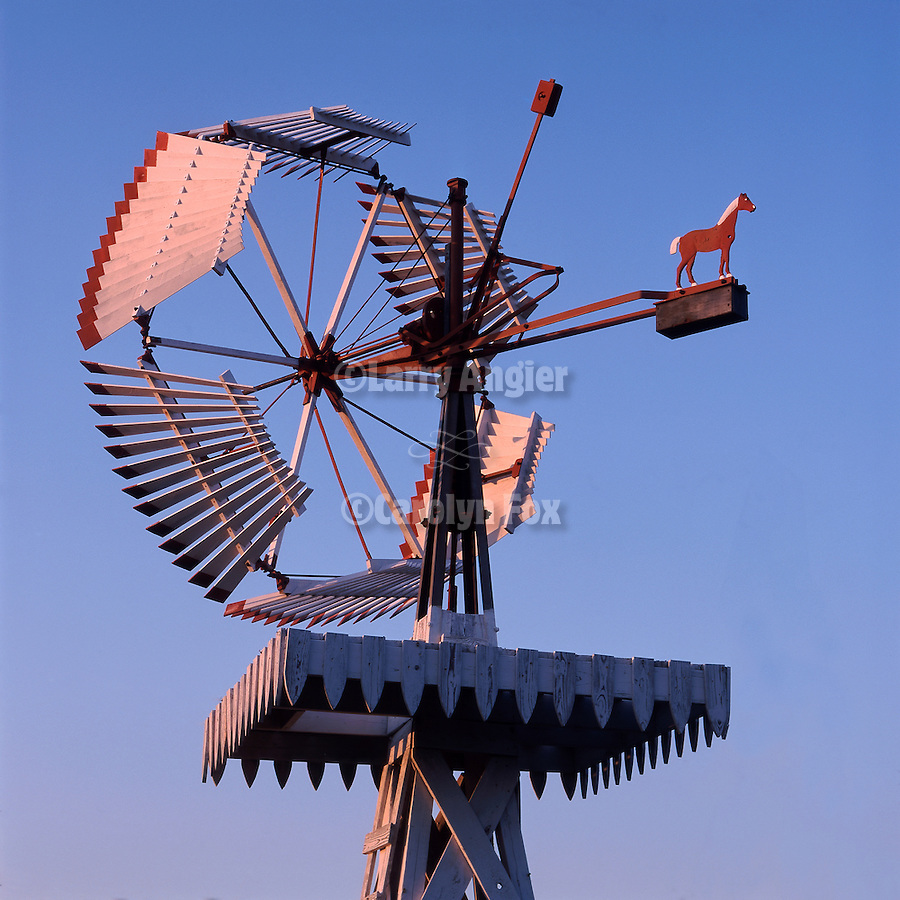 Dempster No. 3 wooden windmill on display in Shattuck, Oklahoma..No. 3 vanes windmills were manufactured between 1906 and 1917. In 1916 Dempster started building No. 4 vaneless windmills...Note: tower on lower right has been removed from this image.