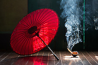 red umbrella and incense in a monastery in Yangon, Myanmar
