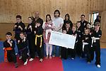 Kempo Karate Kids Present Cheque to Baby Gretta