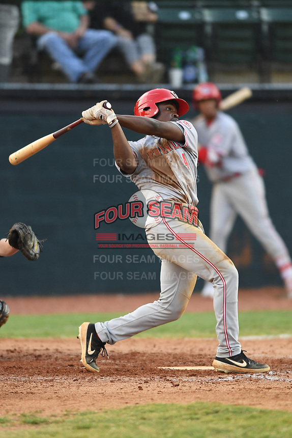 Ivan Johnson (4) of the Greeneville Reds follows through on his swing during a game against the Bristol Pirates at Boyce Cox Field on July 31, 2019 in Bristol, Virginia. The Pirates defeated the Reds 13-3. (Tracy Proffitt/Four Seam Images)