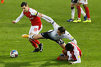 Connor Roberts of Swansea City (C) challenged by Trevor Clarke of Rotherham (L) during the Sky Bet Championship between Swansea City and Rotherham at the Liberty Stadium, Swansea, Wales, UK. Saturday 21 November 2020