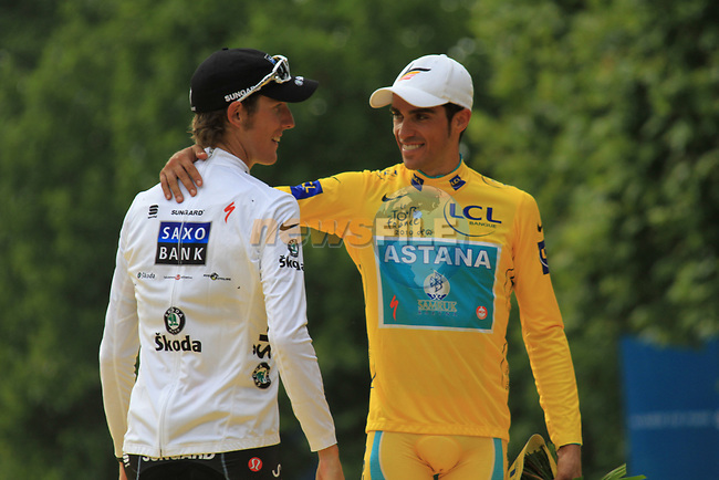 Alberto Contador (ESP) Astana hugs 2nd place and White Jersey Andy Schleck (LUX) Saxo Bank on the podium after winning his 3rd Tour de France at the end of the final Stage 20 of the 2010 Tour de France running 102.5km from Longjumeau to Paris Champs-Elysees, France. 25th July 2010.<br /> (Photo by Eoin Clarke/NEWSFILE).<br /> All photos usage must carry mandatory copyright credit (© NEWSFILE | Eoin Clarke)