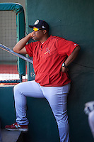 Peoria Chiefs pitching coach Dernier Orozco (22) in the dugout during the second game of a doubleheader against the South Bend Cubs on July 25, 2016 at Four Winds Field in South Bend, Indiana.  South Bend defeated Peoria 9-2.  (Mike Janes/Four Seam Images)
