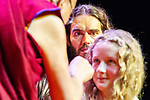 © Joel Goodman - 07973 332324 . 16/06/2012 . Manchester , UK .  KILA CURRAN COLEMAN (right) , 13 , from County Limerick in the Republic of Ireland receives an award for forgiveness from the DALAI LAMA (left) as RUSSELL BRAND (centre) looks on . Kia's father Pat Coleman was murdered in Limerick six years ago in an unprovoked attack and she wrote a letter of forgiveness to her father's killer . Stand Up and Be the Change youth event , hosted by the Dalai Lama during a 10 day UK tour , at the Manchester Arena . Photo credit : Joel Goodman