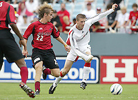 26 June 2004: DC United Joshua Gros dribbles the ball away from Dallas Burn Defender Philip Salyer at Cotton Bowl in Dallas, Texas.   DC United and Dallas Burn are tied 1-1 after the game.   Credit: Michael Pimentel / ISI