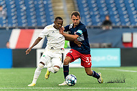 FOXBOROUGH, MA - AUGUST 5: Jay Tee Kamara #19 of North Carolina FC and Jake Rozhansky #32 of New England Revolution II battle for the ball during a game between North Carolina FC and New England Revolution II at Gillette Stadium on August 5, 2021 in Foxborough, Massachusetts.