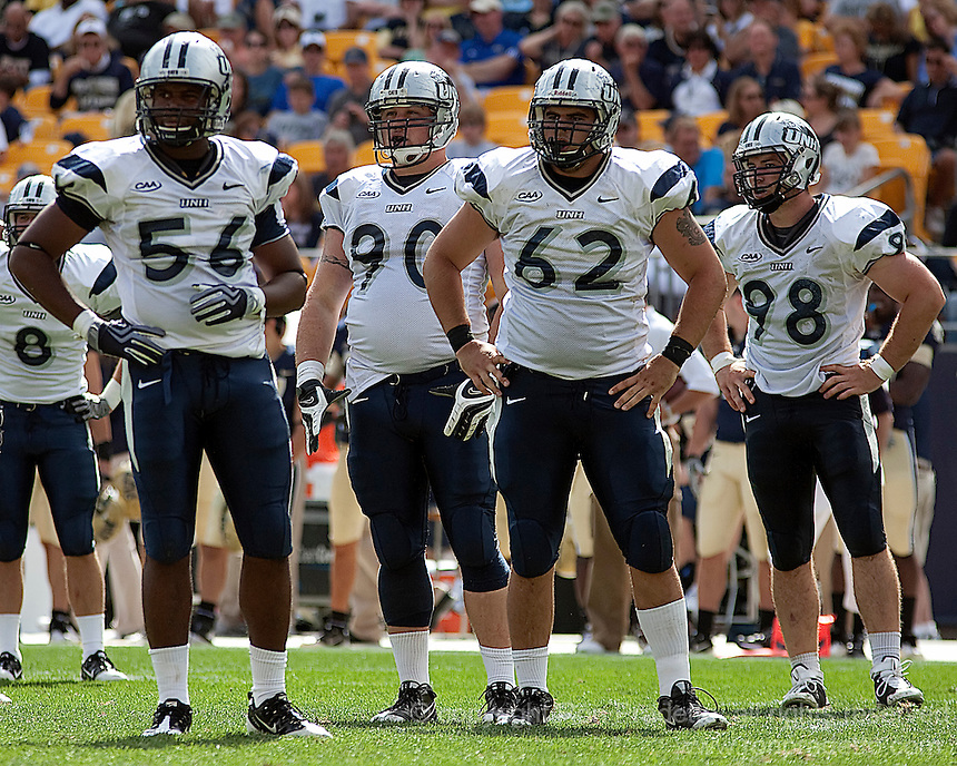 The New Hampshire defensive line await the next play. Pictured are James Jenkins (56), Jared Smith (90), John Murray (62) and Brian McNally (98). The Pittsburgh Panthers defeat the New Hampshire Wildcats 38-16 at Heinz Field, Pittsburgh Pennsylvania on September 11, 2010.