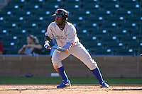 Salt River Rafters outfielder Roemon Fields (8) lays down a bunt during an Arizona Fall League game against the Surprise Saguaros on October 20, 2015 at Salt River Fields at Talking Stick in Scottsdale, Arizona.  Surprise defeated Salt River 3-1.  (Mike Janes/Four Seam Images)
