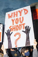 """Thousands gathered outside the Massachusetts State House in Boston, Massachusetts, on Sun., May 31, 2020, to demonstrate against police brutality after the killing by police of George Floyd in Minneapolis, Minnesota, the previous week. Protests, sometimes violent, have erupted around the United States. This protest was organized by an organization called Black Boston. Protesters often chanted """"Black Lives Matter"""" and """"Fuck the police."""" The protest began at 6:30pm in various parts of the city, and around 9pm, after most protesters had left, there began to be clashes between people and police, especially in the Downtown Crossing area of Boston and around Boston Common.  The protest signs here reads """"Why'd You Shoot"""" and shows a silhouette of hands up."""