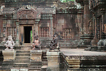 Angkorian temple Banteay Srei (late 10th century) 967.<br /> Doorway on right into northern tower sanctuary.<br /> Banteay Srei temple is situated 20km north of Angkor, built during the reign of Rajendravarman by Yajnavaraha, one of his counsellors. In antiquity Isvarapura was a small city that grew up around the temple. Banteay Srei was dedicated to the worship of Shiva, the foundation stele describes the consecration of the linga Tribhuvanamahesvara (Lord of the three worlds) in 967.