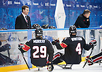 Sochi, RUSSIA - Mar 9 2014 -  Graeme Murray and Derek Whitson talks to Head Coach Mike Mondin during Canada vs. Norway at the 2014 Paralympic Winter Games in Sochi, Russia.  (Photo: Matthew Murnaghan/Canadian Paralympic Committee)