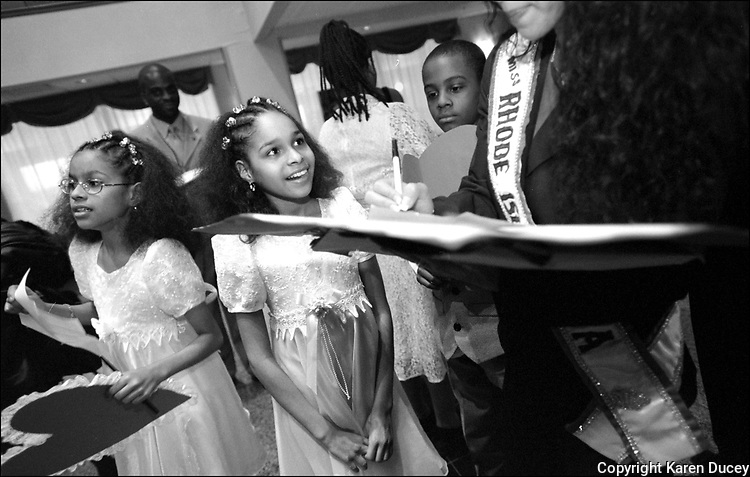 Drew Elementary students Brittany Tinoco (center) and her sister Brianna greet Miss USA delegates at the Trump Hotel in Buffington Harbor upon their arrival in Gary, Indiana on Valentines Day......