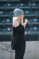 A young singer performs the national anthem before a Pioneer League game between the Missoula Osprey and the Grand Junction Rockies at Ogren Park Allegiance Field on August 21, 2018 in Missoula, Montana. The Missoula Osprey defeated the Grand Junction Rockies by a score of 2-1. (Zachary Lucy/Four Seam Images)