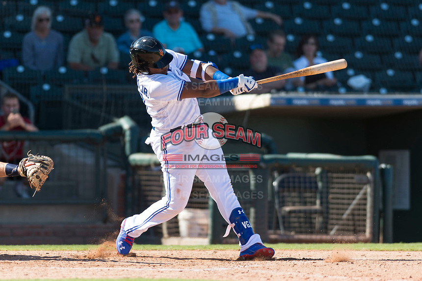 Surprise Saguaros designated hitter Vladimir Guerrero Jr. (27), of the Toronto Blue Jays organization, swings at a pitch during an Arizona Fall League game against the Peoria Javelinas at Surprise Stadium on October 17, 2018 in Surprise, Arizona. (Zachary Lucy/Four Seam Images)