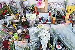 © Joel Goodman - 07973 332324 . 02/01/2012 . Salford , UK . The parents of Anuj Bidve visit the scene of Anuj Bidve's murder, on Ordsall Lane , where a memorial shrine of flowers, candles and messages has been built . Bidve was shot and killed by Kiaran Stapleton on 26 December 2011 . Photo credit: Joel Goodman