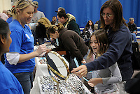 A mother and daughter pick out a pair of glasses at the mobile clinic set up by Remote Area Medical (RAM). Over the weekend at Soft Shell, Knott County, in the Appalachian mountains of eastern Kentucky, the congressional district with the nation's lowest life expectancy, RAM volunteers saw 822 needy people. 95 percent of people seen were provided with dental or optical care. RAM was founded in 1985 to provide free health, dental and eye care in the developing world. However, RAM now provides 60 percent of its services in the US, providing for the estimated 47 million Americans without health insurance..