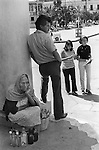 San Cristobal de las Casas, Mexico. Poverty woman hoping to sell ordinary old bottles to the few American tourists in town. 1970s 1973