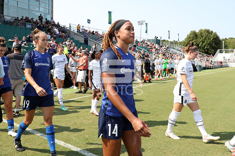 CARY, NC - SEPTEMBER 12: Jessica McDonald #14 of the North Carolina Courage enters the field as part of the ceremonial walkout before a game between Portland Thorns FC and North Carolina Courage at Sahlen's Stadium at WakeMed Soccer Park on September 12, 2021 in Cary, North Carolina.