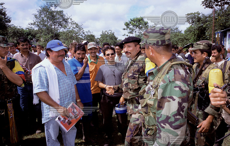 Guerilla leader and military chief of the FARC (Revolutionary Armed Forces of Colombia), Jorge Briceno - also known as the Mono Jojoy - greets peasants in the department of Meta.