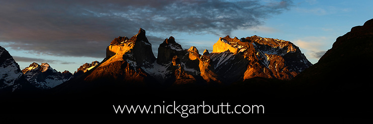 Dramatic light at sunset on the Towers and Central Massif of Torres del Paine. Torres del Paine National Park, Patagonia, Chile.