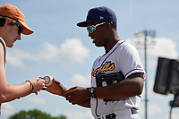 Montgomery Biscuits Jesus Sanchez (4) signs a home run ball for a fan a Southern League game against the Mobile BayBears on May 2, 2019 at Riverwalk Stadium in Montgomery, Alabama.  Mobile defeated Montgomery 3-1.  (Mike Janes/Four Seam Images)