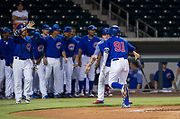 AZL Cubs center fielder Jose Gutierrez (91) is congratulated by teammates after hitting a lead-off home run in the first inning against the AZL Giants on September 6, 2017 at Sloan Park in Mesa, Arizona. AZL Giants defeated the AZL Cubs 6-5 to even up the Arizona League Championship Series at one game a piece. (Zachary Lucy/Four Seam Images)
