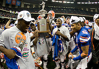 01 January 2010:  Florida players celebrates with Sugar Bowl trophy after winning the game against Cincinnati during Sugar Bowl at the SuperDome in New Orleans, Louisiana.  Florida defeated Cincinnati, 51-24.