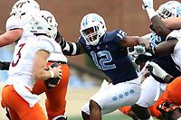 CHAPEL HILL, NC - OCTOBER 10: Tomon Fox #12 of North Carolina rushes quarterback Braxton Burmeister #3 of Virginia Tech during a game between Virginia Tech and North Carolina at Kenan Memorial Stadium on October 10, 2020 in Chapel Hill, North Carolina.