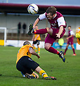 Arbroath's Craig Johnstone (top) is challenged by Annan's Ian Chisholm.