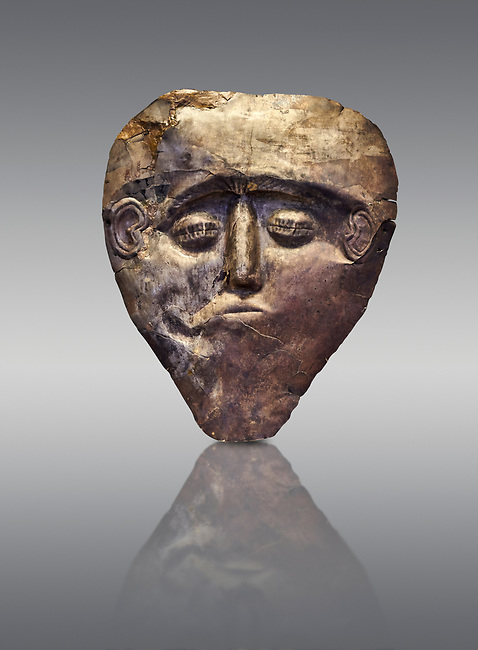 Electrum, gold silver alloy, Mycenaean death mask from Grave delta and Gamma, Grave Circle B, Mycenae, Greece. National Archaeological Museum of Athens.  Grey Background