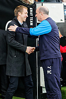 (L-R) Graham Potter, manager for Swansea City greets Paul Cook, manager for Wigan Athletic during the Sky Bet Championship match between Swansea City and Wigan Athletic at the Liberty Stadium, Swansea, Wales, UK. Saturday 29 December 2018