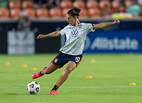 HOUSTON, TX - JUNE 13: Carli Lloyd #10 of the USWNT warms up before a game between Jamaica and USWNT at BBVA Stadium on June 13, 2021 in Houston, Texas.