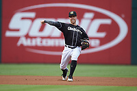 Charlotte Knights shortstop Jake Elmore (3) makes a throw to first base against the Pawtucket Red Sox at BB&T BallPark on July 19, 2018 in Charlotte, North Carolina. The Knights defeated the Red Sox 4-3.  (Brian Westerholt/Four Seam Images)