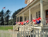 Heceta House and Lighthouse with flag decorations. Devil's Elbow State Park, Oregon