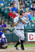 Omaha Storm Chasers first baseman Clint Robinson #25 swings during the Pacific Coast League baseball game against the Round Rock Express on July 22, 2012 at the Dell Diamond in Round Rock, Texas. The Express defeated the Chasers 8-7 in 11 innings. (Andrew Woolley/Four Seam Images).