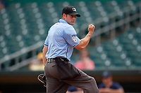 Umpire Ben Sonntag calls a runner out at home during a Southern League game between the Mobile BayBears and Montgomery Biscuits on May 2, 2019 at Riverwalk Stadium in Montgomery, Alabama.  Mobile defeated Montgomery 3-1.  (Mike Janes/Four Seam Images)